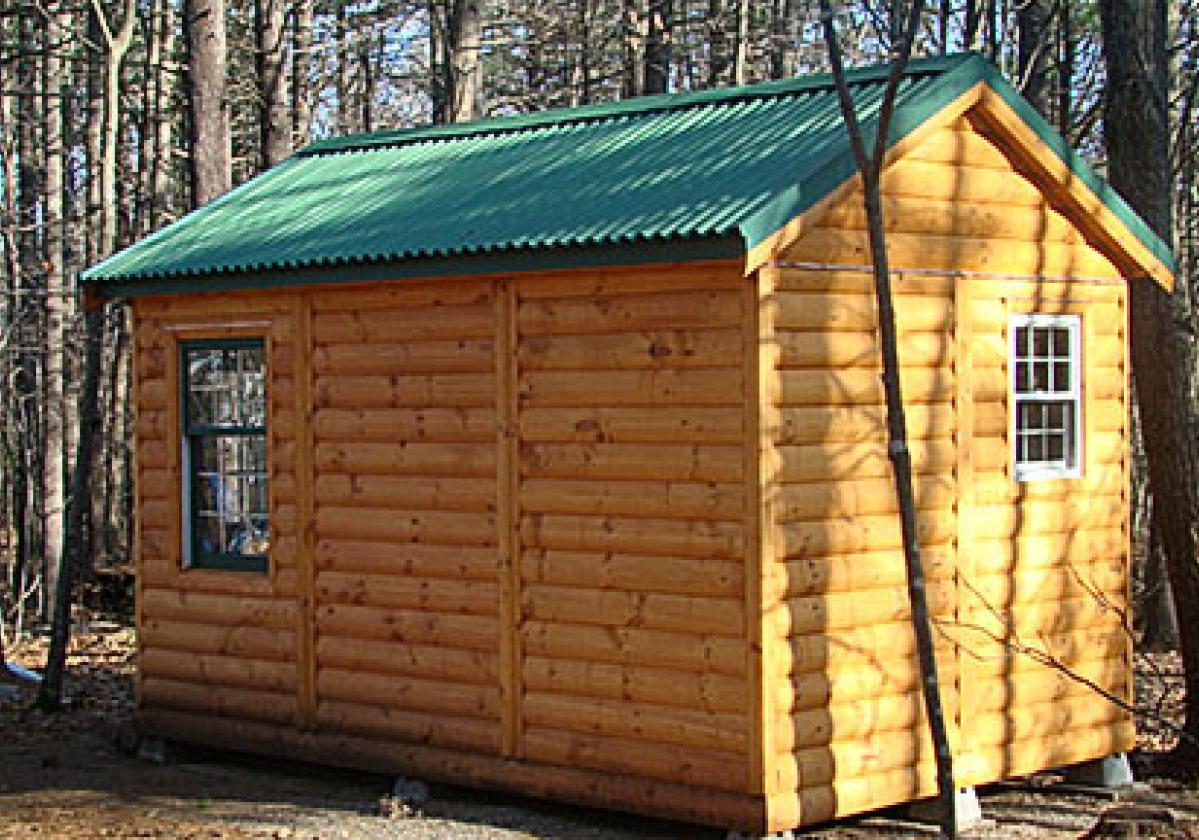 Cabaña con cubierta ONDURA® verde