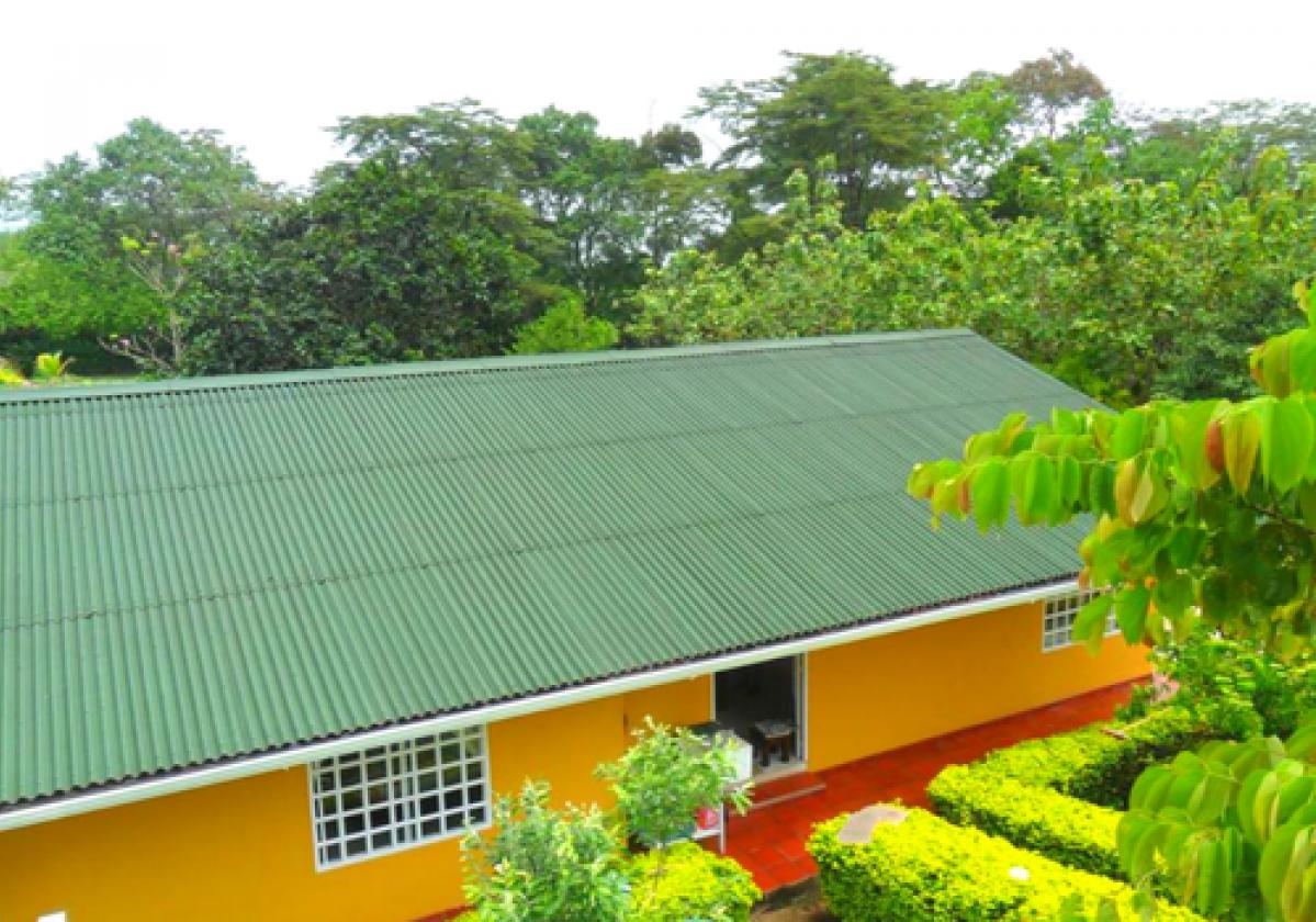 Casa residencial con cubierta ONDURA® verde